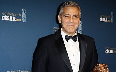 Actor George Clooney poses with the Honorary Cesar award during a photocall at the 42nd Cesar Film Awards ceremony at Salle Pleyel in Paris, Friday, Feb. 24, 2017. This annual ceremony is presented by the French Academy of Cinema Arts and Techniques. (AP/Francois Mori)
