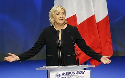 Far-right leader presidential candidate Marine Le Pen gestures as she speaks during a conference in Lyon, France, Sunday, Feb. 5, 2017. (AP Photo/Michel Euler)