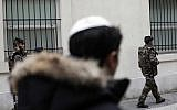 French soldiers patrol next to a Jewish school, in Paris. Jan. 13, 2015. (AP Photo/Thibault Camus)