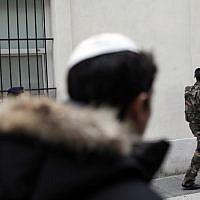 French soldiers patrol next to a Jewish school, in Paris. Jan. 13, 2015. (AP Photo/Thibault Camus)