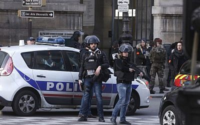 Police officers guard the access to the Louvre museum in Paris,Friday, Feb. 3, 2017. (AP Photo/Thibault Camus)