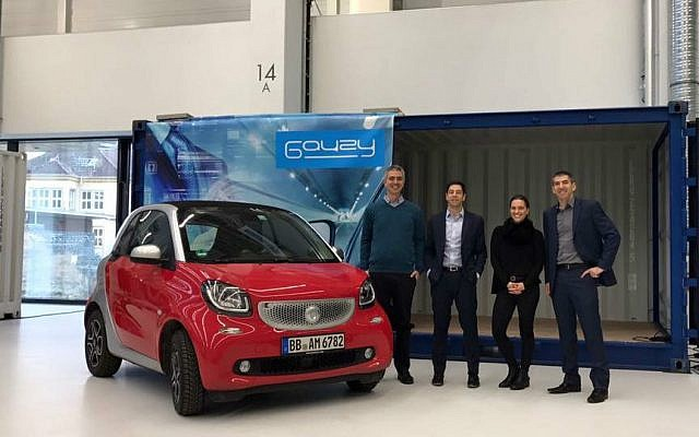 The Gauzy team with a Smart Fortwo car in Stuttgart, Germany (Courtesy