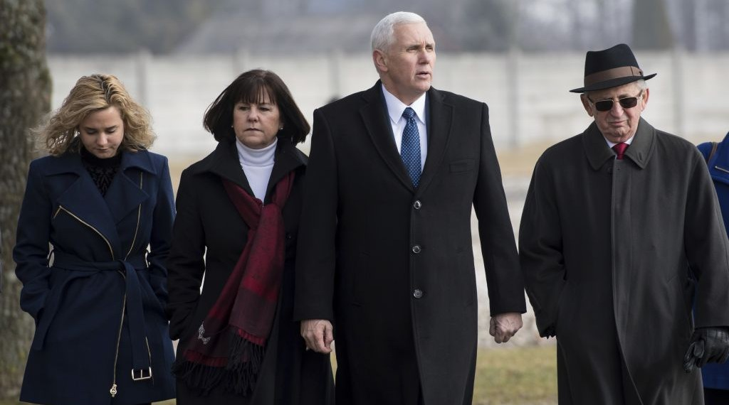 U.S. Vice President Mike Pence, center, his wife Karen, second from left, and his daughter Charlotte, left, are lead by Holocaust survivor Abba Naor, right, as they visit the former Nazi concentration camp in Dachau near Munich, southern Germany, Sunday, Feb. 19, 2017, one day after he attended the Munich Security Conference. (Sven Hoppe/pool photo via AP)