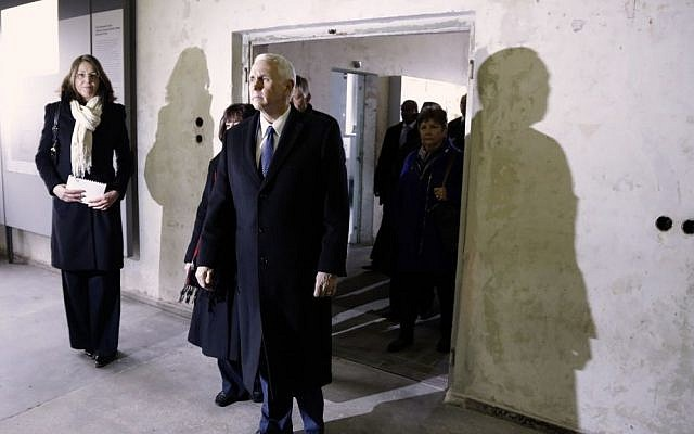 US Vice President Mike Pence during a visit to the memorial site in the former Nazi concentration camp in Dachau near Munich, Germany, Sunday, Feb. 19, 2017. (AP Photo/Matthias Schrader)