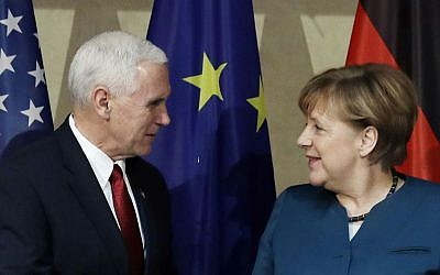 United States Vice President Mike Pence, left, and German Chancellor Angela Merkel meet for bilateral talks during the Munich Security Conference in Munich, Germany, Saturday, Feb. 18, 2017. (AP Photo/Matthias Schrader)