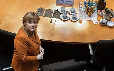 German Chancellor Angela Merkel waits for the beginning of a questioning at an investigation committee of the German federal parliament looking into alleged US surveillance in Germany and the activities of Germany's own foreign intelligence service in Berlin, Germany, Thursday, Feb. 16, 2017. (Bernd von Jutrczenka/dpa via AP)