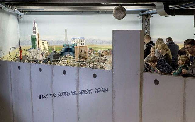 In this Jan. 31, 2017 photo visitors to the miniature wonderland in Hamburg , Germany, can only look at a model landscape of the United States from behind a wall . (Christian Charisius/dpa via AP)