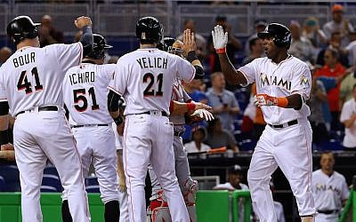 The Miami Marlins during a game against the Washington Nationals at Marlins Park in Miami, Fla., April 21, 2016. (Mike Ehrmann/Getty Images via JTA)