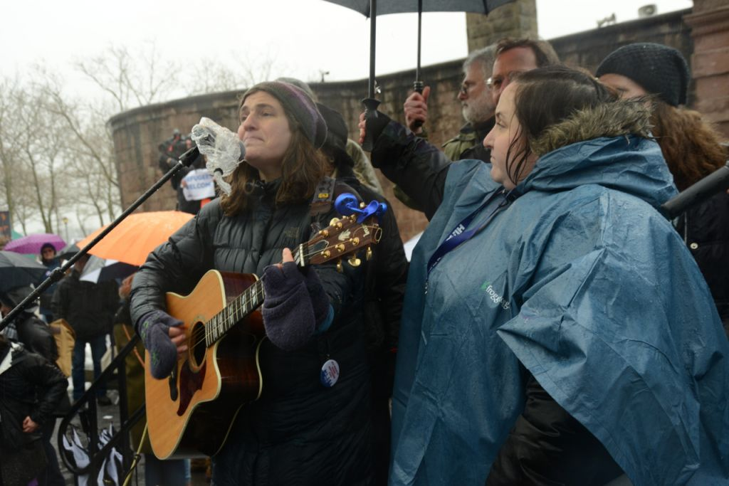Singer/songwriter Chana Rothman (left) and Rabbi Rachel Grant Meyer, Director of Education at HIAS, the global Jewish nonprofit that protects refugees, participate in the Jewish Rally for Refugees in Battery Park, New York, on February 12, 2017. (Courtesy HIAS)
