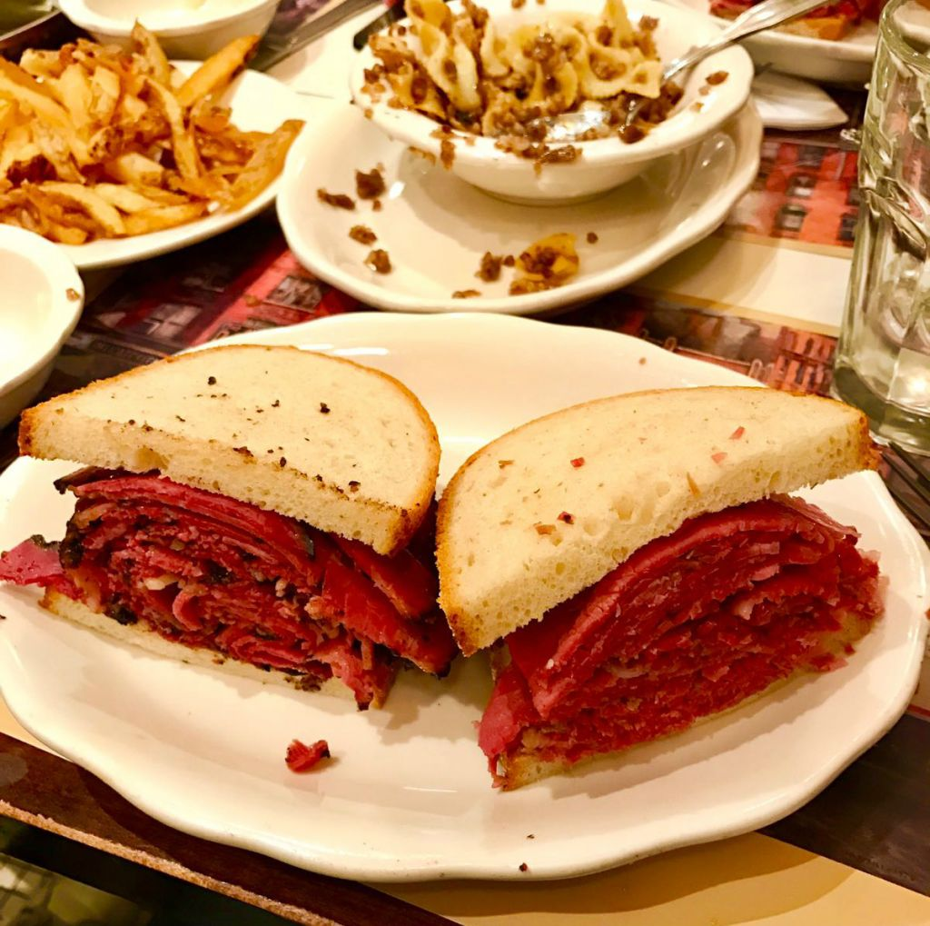 Half corned beef, half pastrami at 2nd Avenue Deli, in Midtown, New York. Note kasha varnishkes in the background. (Shimmie Pesis/Times of Israel)