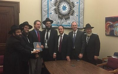 A delegation of rabbis presenting a Chumash to Montana's Governor Steve Bullock (courtesy)