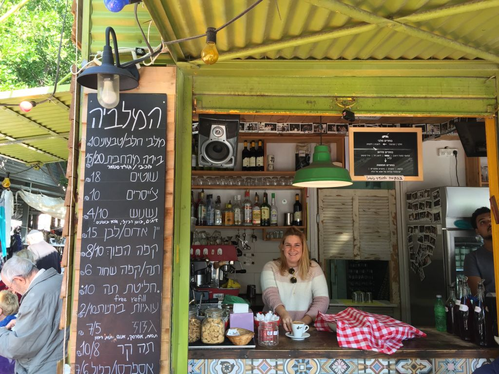 Serving up dishes of malabi and shots of coffee at HaMalabiya (Jessica Steinberg/Times of Israel)