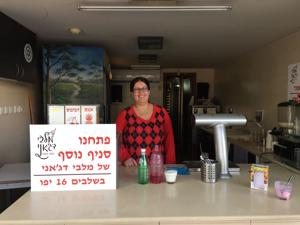 Sarit Levi, the third generation of her family to sell malabi at Dajani, their Jaffa storefront (Jessica Steinberg/Times of Israel)