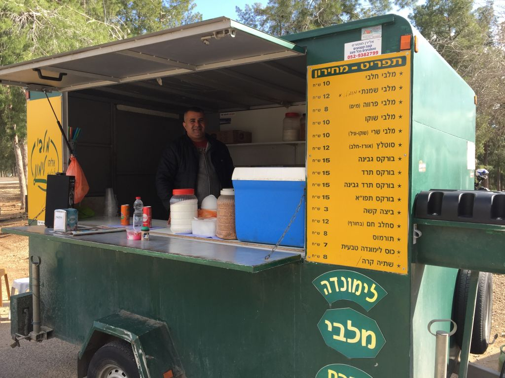 Shachar xx at Malabi Halimon at the Ben Shemen Forest off of Route 443, where the malabi is topped with soft, crushed peanuts (Jessica Steinberg/Times of Israel)