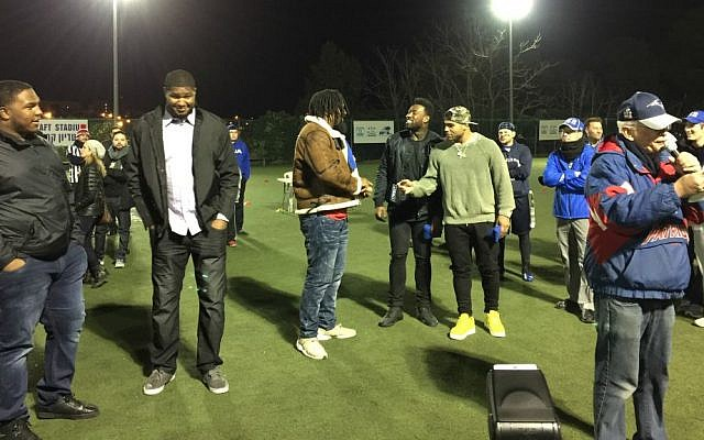 The five NFL players who came to Israel visited briefly at Jerusalem's Kraft Stadium Saturday night, February 18, 2017. From left to right, they are Dan Williams, Calais Campbell, Cameron Jordan, Delanie Walker and Mychal Kendricks, with AFI founder Steve Leibowitz in the foreground (Jessica Steinberg/Times of Israel)