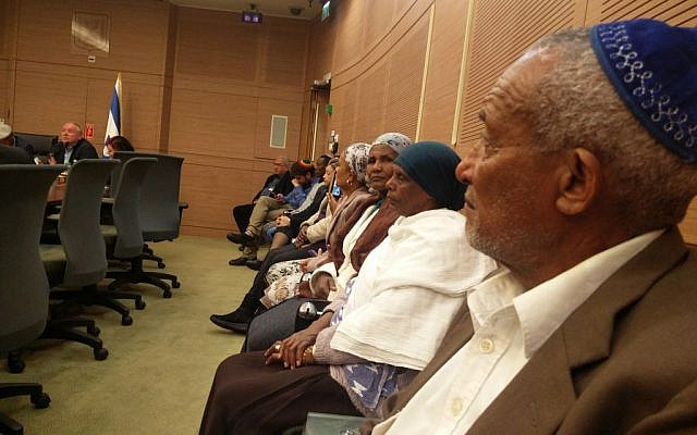 Ethiopian Israelis attend a Knesset committee meeting on the government's failure to implement a decision to bring 1,300 member of the Jewish community from Ethiopia to Israel, February 20, 2017. (Raoul Wootliff/Times of Israel)