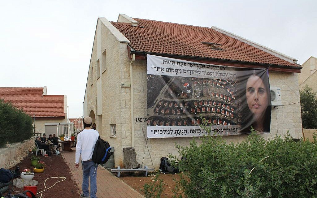 A giant poster of Justice Minister Ayelet Shaked adorns a home slated for demolition in Ofra on Tuesday February 28, 2017 (Raoul Wootliff/Times of Israel)