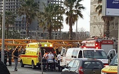 EMTs treat the injured after a crane collapsed at a construction site in the central Israel city of Bat Yam on February 13, 2017. (Magen David Adom spokeswoman)