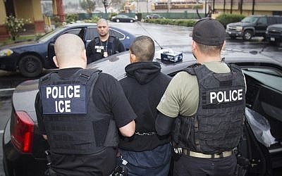 In this photo taken Feb. 7, 2017, an arrest is made during a targeted enforcement operation conducted by US Immigration and Customs Enforcement (ICE) aimed at immigration fugitives, re-entrants and at-large criminal aliens in Los Angeles. (Charles Reed/US Immigration and Customs Enforcement via AP)