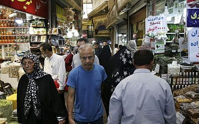 In this July 19, 2016 file photo, Iranians walk through Tajrish bazaar in northern Tehran, Iran. (AP Photo/Vahid Salemi, File)