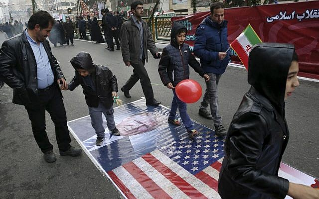 Iranians march on a portrait of U.S. President Donald Trump and the picture of U.S. flag in an annual rally commemorating the anniversary of the 1979 Islamic revolution, which toppled the late pro-US Shah, Mohammad Reza Pahlavi, in Tehran, Iran, Friday, Feb. 10, 2017. (Vahid Salemi/AP)