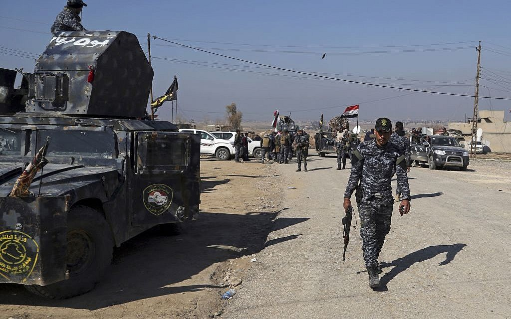 Iraqi Federal police deploy after regaining control of the town of Abu Saif, west of Mosul, Iraq, February 22, 2017. (AP Photo/Khalid Mohammed)