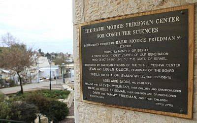 A writing at the women's seminary building donated by US ambassador to Israel designate David Friedman is seen in the West Bank settlement of Beit El near Ramallah Thursday, Feb. 16, 2017. (AP Photo/Tsafrir Abayov)