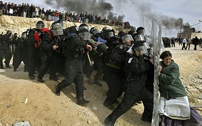 This Pulitzer Prize winning photograph by Oded Balilty shows Israeli settlers challenging security forces at the West Bank outpost of Amona on February 1, 2006. (AP Photo/Oded Balilty)