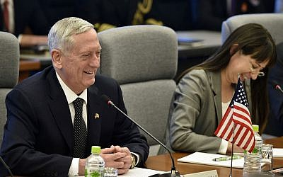 US Defense Secretary Jim Mattis, left, smiles while speaking to Japanese Defense Minister Tomomi Inada, unseen, at the start of their meeting at Defense Ministry in Tokyo, Saturday, Feb. 4, 2017. (Franck Robichon/Pool Photo via AP)