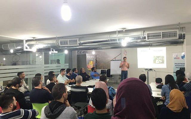 PIP program coordinator Jesse Divon speaks to prospective applicants in Jerusalem on November 14th, 2016. (Courtesy)