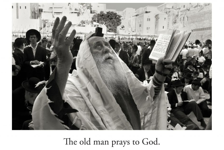 A man praying is one of the images in 'L'Chaim!' (Rainbow Ridge Books/via JTA)