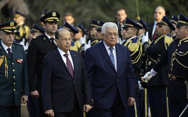 Lebanese President Michel Aoun, left, and his Palestinian counterpart Mahmoud Abbas, right, review the honor guard upon Abbas's arrival at the presidential palace in Beirut, Lebanon, Thursday, Feb. 23, 2017. (AP Photo/Hussein Malla)