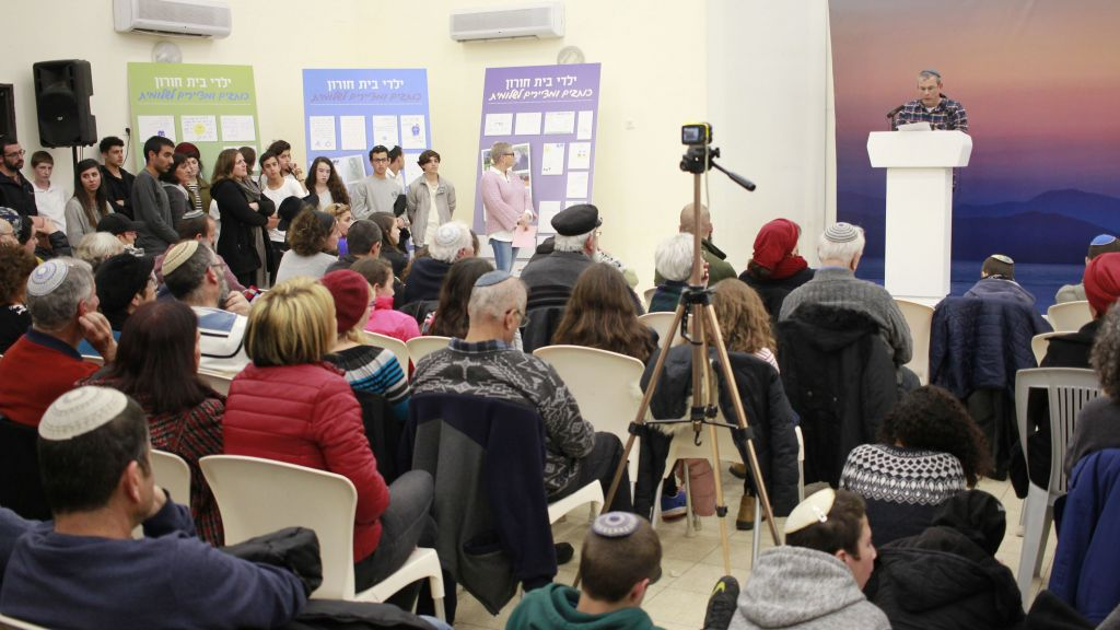 Tzachi Krigman speaks about his daughter, Shlomit, on February 12, 2017, a year after she was killed in a terror attack at the Beit Horon settlement, near Jerusalem. (Judah Ari Gross/Times of Israel)