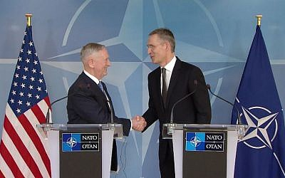 US Defense Secretary James Mattis (R) and NATO Secretary General Jens Stoltenberg shake hands after giving a joint statement to kick-off NATO's two-day long ministerial meeting in Brussels on Wednesday, February 15, 2017. (Screen capture/YouTube)