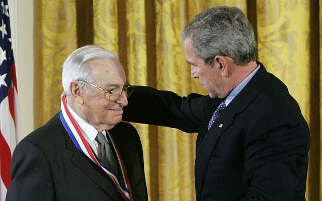 This Feb. 13, 2006 file photo shows then-US president George W. Bush, right, presenting the National Medal of Science to Dr. Kenneth J. Arrow, left, from Stanford University, during a ceremony in the East Room of the White House in Washington. (AP Photo/Pablo Martinez Monsivais, File)