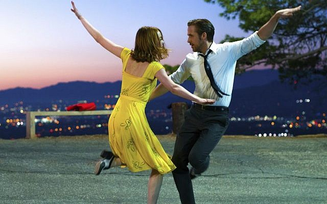"This image released by Lionsgate shows Ryan Gosling, right, and Emma Stone in a scene from, ""La La Land."" The film is nominated for an Oscar for best picture. (Dale Robinette/Lionsgate via AP)"