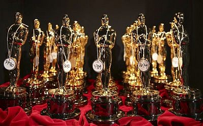 This March 2, 2014 file photo shows Oscar statues lined up backstage during the Oscars in Los Angeles. (Matt Sayles/Invision/AP, File)