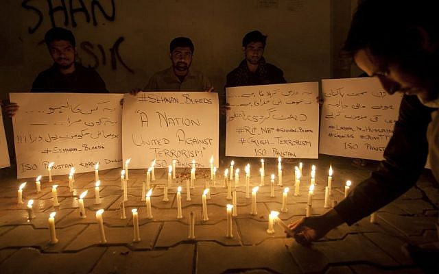 Pakistani students light candles to condemn the recent attack on a shrine in interior Sind province, Thursday, Feb. 16, 2017 in Karachi, Pakistan. (AP Photo/Shakil Adil)