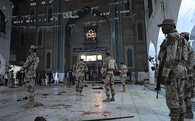 Pakistani para-military soldiers stand alert after a deadly suicide attack at the shrine of famous Sufi Lal Shahbaz Qalandar in Sehwan, Pakistan, Thursday, Feb. 16, 2017. (AP Photo/Pervez Masih)