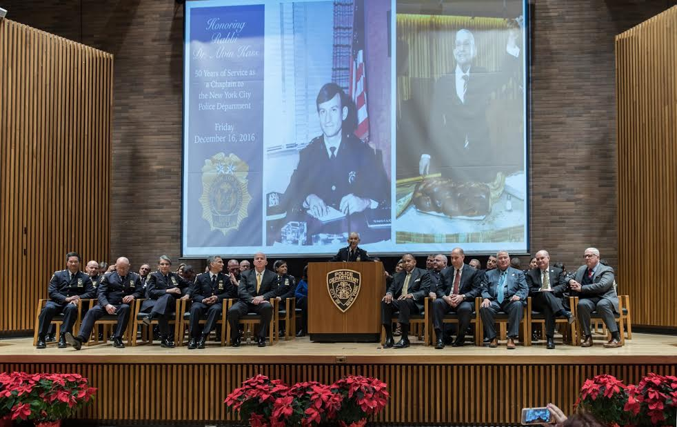 Rabbi Alvin Kass addresses NYPD executive staff on the dais of the 1 Police Plaza auditorium. (Courtesy Lt. Steven A. Jerome)