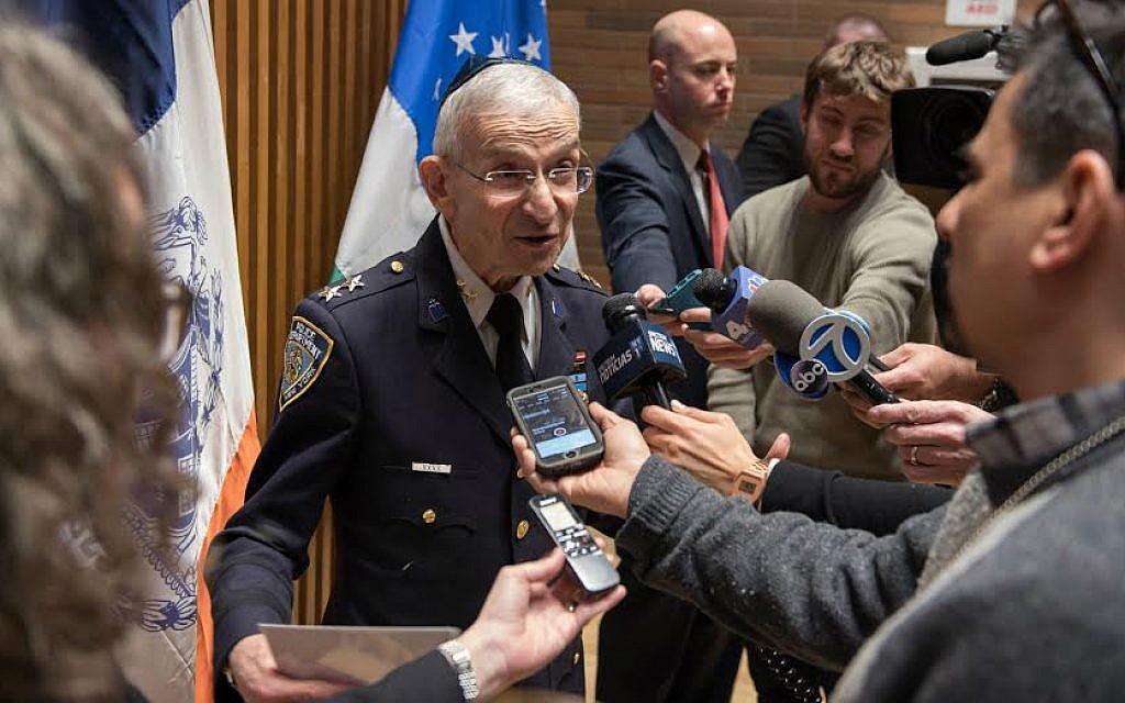 Rabbi Alvin Kass addressing members of the press. (Courtesy Lt. Steven A. Jerome)