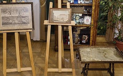 An 18-century map of Poland built into a small table and two old drawings that were returned to Poland on Sunday by Austria's Horst von Waechter, whose family had looted them from Krakow during World War II. Waechter's father, Otto von Waechter, was a Nazi governor of the occupied city.  Feb.ruary 26, 2017 in Krakow, Poland. (Office of the Governor Malopolska via AP)