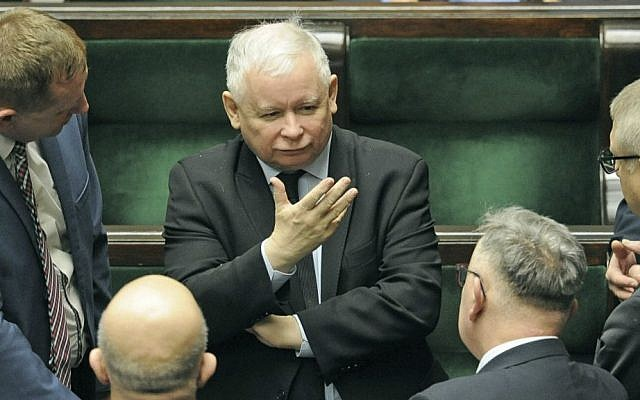 In this Jan. 25, 2017 file photo, Jaroslaw Kaczynski, center, the leader of the ruling Law and Justice party, speaks with lawmakers in parliament in Warsaw, Poland. (AP Photo/Alik Keplicz)