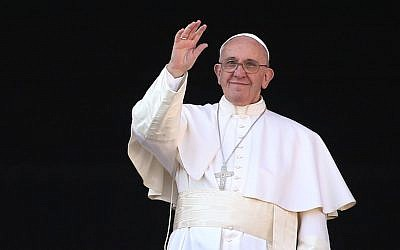 Pope Francis waves to the faithful as he delivers his 'Urbi et Orbi' blessing message from the central balcony of St Peter's Basilica on December 25, 2015 in Vatican City, Vatican. (Franco Origlia/Getty Images via JTA)