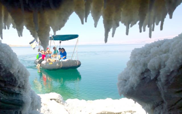 Jaky Ben Zaken's boat on the Dead Sea seen from a salt cave. (courtesy Noam Bedein)