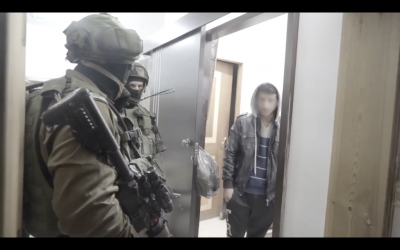 IDF troops arrest a Palestinian teenager suspected of being a member of a group that has thrown Molotov cocktails at West Bank highways over the past few months. (Screen capture: IDF Spokesperson's Unit)