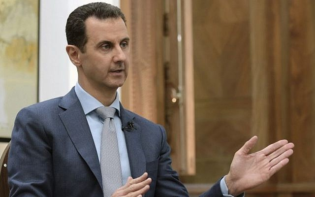 Syrian President Bashar Assad speaks during an interview with Yahoo News in Damascus, Syria, Friday, Feb. 10, 2017 (SANA via AP)