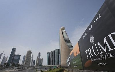 A giant billboard advertising the Trump International Golf Club hangs at the Dubai Trade Center roundabout, in Dubai, United Arab Emirates on February 18, 2017. (AP Photo/Kamran Jebreili)