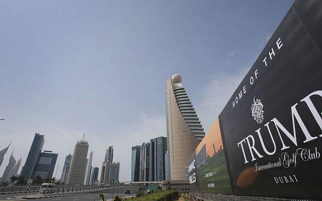 A giant billboard advertising the Trump International Golf Club hangs at the Dubai Trade Center roundabout, in Dubai, United Arab Emirates on February 18, 2017. (AP Photo/Kamran Jebreili)