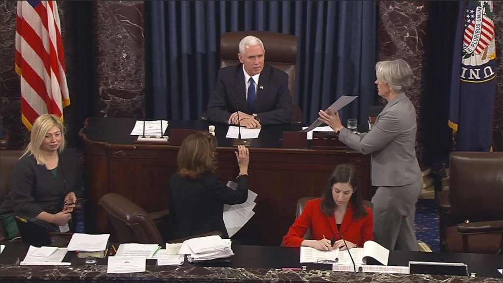 In this image from video, provided by Senate Television shows Vice President Mike Pence presiding over the Senate on Capitol Hill in Washington, Tuesday, Feb. 7, 2017, during the Senate's vote on Education Secretary-designate Betsy DeVos. (Senate Television via AP)